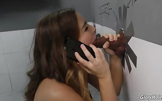 Natasha Ultra-Cute is deep-throating a stranger's sausage thru a gloryhole, to make him pour out from delight