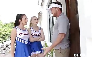 Insatiable cheerleaders and a stunning coach are having a good tear up time, on the bed